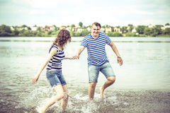Pretty couple outdoor, running on the lake Royalty Free Stock Photo