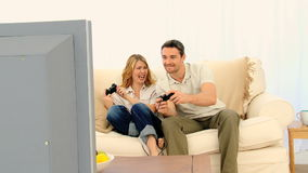 Pretty couple playing a video game stock video