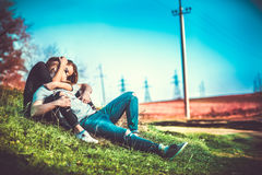 Pretty couple rest outdoor in the forest Royalty Free Stock Image