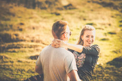 Pretty couple rest outdoor in the forest stock photography