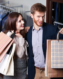 Pretty couple show their packets with gifts Royalty Free Stock Photography