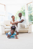 Pretty couple sitting on couch and their daughter using digital tablet Royalty Free Stock Images