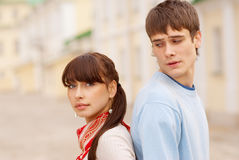 Pretty couple standing back to back Stock Images