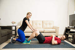 Pretty couple working out together Stock Photography