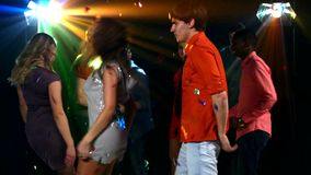 Pretty couple of young people dancing at a party stock video footage