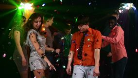 Pretty couple of young people dancing at a party stock footage