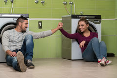Pretty Couples In The Laundry Room Stock Photos