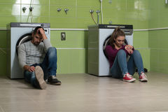 Pretty Couples In The Laundry Room Stock Image