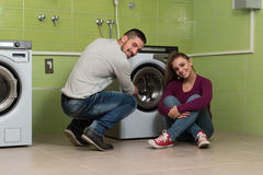 Pretty Couples In The Laundry Room Stock Images
