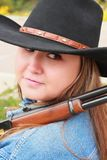 Pretty Cowgirl with 30-30 Rifle Royalty Free Stock Photo