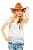 Pretty cowgirl in hat, white blouse and jeans Stock Photos