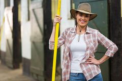 Pretty cowgirl pitch fork Stock Image