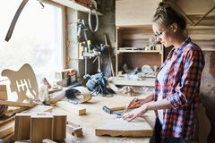 Pretty Craftswoman Measuring Plank royalty free stock photo