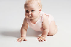 Pretty crawling baby.adorable baby girl. funny child Royalty Free Stock Photos