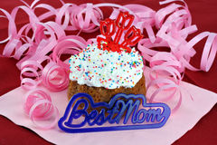 Pretty cupcake for mom with Best Mom in front. Royalty Free Stock Photo