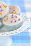 Pretty Cupcakes. Pretty iced cupcakes displayed on glass stand Royalty Free Stock Image