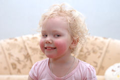 Pretty curly blond girl make faces. Stock Photo