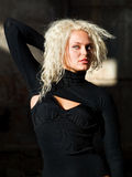 Pretty curly blonde looking away Stock Images