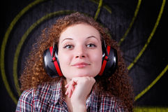 Pretty curly girl with headphones Royalty Free Stock Image
