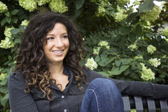 Pretty Curly Haired Woman Smiles into the Distance Royalty Free Stock Photo