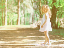 Pretty curly little girl in summer Stock Photo