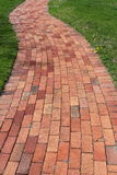 Pretty curved brick walkway Royalty Free Stock Photos