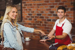 Pretty customer making a mobile payment Stock Photos