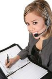 Pretty Customer Service Woman. A pretty customer service woman taking notes Royalty Free Stock Image