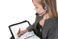 Pretty Customer Service Woman. A pretty customer service woman taking notes Stock Images