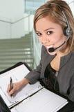 Pretty Customer Service Woman. A pretty customer service woman taking notes Stock Photos