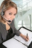 Pretty Customer Service Woman. A pretty customer service woman taking notes Royalty Free Stock Photography