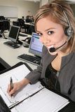 Pretty Customer Service Woman. A pretty customer service woman taking notes Royalty Free Stock Photos