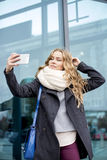 Pretty cute blonde doing Selfe Stock Image
