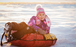 Pretty cute girl on soft sleigh Stock Photos