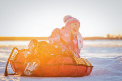 Pretty cute girl on soft sleigh Royalty Free Stock Photos