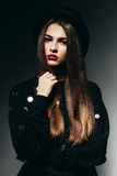 Pretty cute woman in black jumper Stock Image