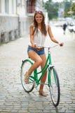Pretty cyclist Stock Photography