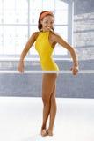 Pretty dancer at ballet bar Royalty Free Stock Photos