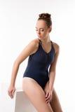 Pretty dancer in blue bodysuit. Studio photo Royalty Free Stock Photo