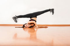 Pretty dancer doing a split and having fun Stock Images