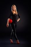 Pretty dancer holding ball Stock Photo