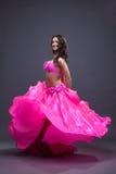 Pretty dancer performing oriental dance Stock Photo