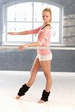 Pretty dancer practicing by bar Royalty Free Stock Images