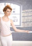 Pretty dancer standing by bar practicing Stock Image