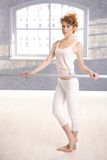 Pretty dancer standing by bar practicing Royalty Free Stock Images
