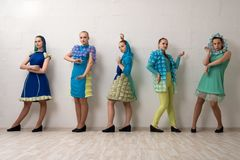 Pretty dancers in colorful dresses shot. Pretty dancers in colorful dresses full-length shot royalty free stock photography