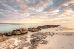 Pretty dappled sunrise sky in the morning at Scottish Rocks, Australia stock photo