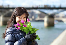 Pretty dark haired girl with tulips Stock Image
