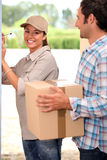 Pretty delivery girl Royalty Free Stock Photo