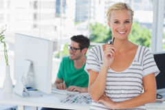 Pretty designer posing in his office Royalty Free Stock Photography